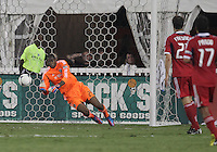 WASHINGTON, DC. - AUGUST 22, 2012:   Sean Johnson (25) of the Chicago Fire makes a save during an MLS match against DC United at RFK Stadium, in Washington DC,  on August 22. United won 4-2.