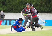 ICC World T20 Qualifier - GROUP B MATCH - AFGHANISTAN v UAE at Grange CC, Edinburgh - UAE's Abdul Shapoor watches as Afghanistan's Hamid Hassan juggles and drops a caught and bowled chance — credit @ICC/Donald MacLeod - 10.07.15 - 07702 319 738 -clanmacleod@btinternet.com - www.donald-macleod.com