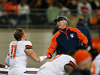 Illinois Fighting Illini head coach Tim Beckman shakes hands with Illinois Fighting Illini tight end Matt LaCosse (11) prior to the NCAA football game at Ohio Stadium on Saturday, November 1, 2014. (Columbus Dispatch photo by Jonathan Quilter)