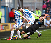 17th March 2018, The John Smiths Stadium, Huddersfield, England; EPL Premier League football, Huddersfield Town versus Crystal Palace; James McArthur of Crystal Palace cries out in pain as he is fouled by Scott Malone and Jonathan Hogg of Huddersfield Town in the first half