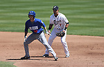 Las Vegas 51s' Zach Wheeler leads off in front of Reno Aces' first baseman Kila Ka'aihue during a minor league baseball game against the Reno Aces in Reno, Nev., on Tuesday, April 30, 2013. (AP Photo/Cathleen Allison)