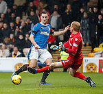 Lee Wallace tries to score past keeper Craig Samson