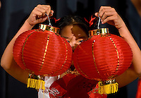 A young girl holds up traditional Chinese lanterns during a Chinese New Year Celebration at UNC Charlotte in Charlotte, NC.