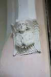 Praying angle figure inside All Saints church, Ellough, Suffolk, England, UK