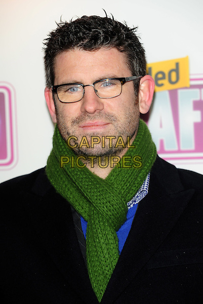 DAN RENTON SKINNER .Attending the Loaded LAFTA's Comedy Awards at the Cuckoo Club, London, England, January 27th 2010..LAFTAs arrivals portrait headshot glasses black jacket beard facial hair  green scarf  .CAP/CJ.©Chris Joseph/Capital Pictures.