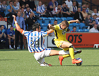 Manuel Pascali fouls James Marwood in the Kilmarnock v St Mirren Scottish Professional Football League Premiership match played at Rugby Park, Kilmarnock on 13.9.14.