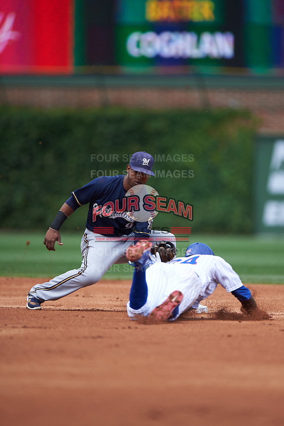 Milwaukee Brewers shortstop Jean Segura (9) tags Dexter Fowler (24) sliding into second during a game against the Chicago Cubs on August 13, 2015 at Wrigley Field in Chicago, Illinois.  Chicago defeated Milwaukee 9-2.  (Mike Janes/Four Seam Images)