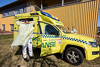 Paramedics in the city of Drammen putting on personal protective equipment (PPE) in order to transport patients during the Covid-19 , coronaviraus, pandemic.<br /> <br /> <br /> ©Fredrik Naumann/Felix Features