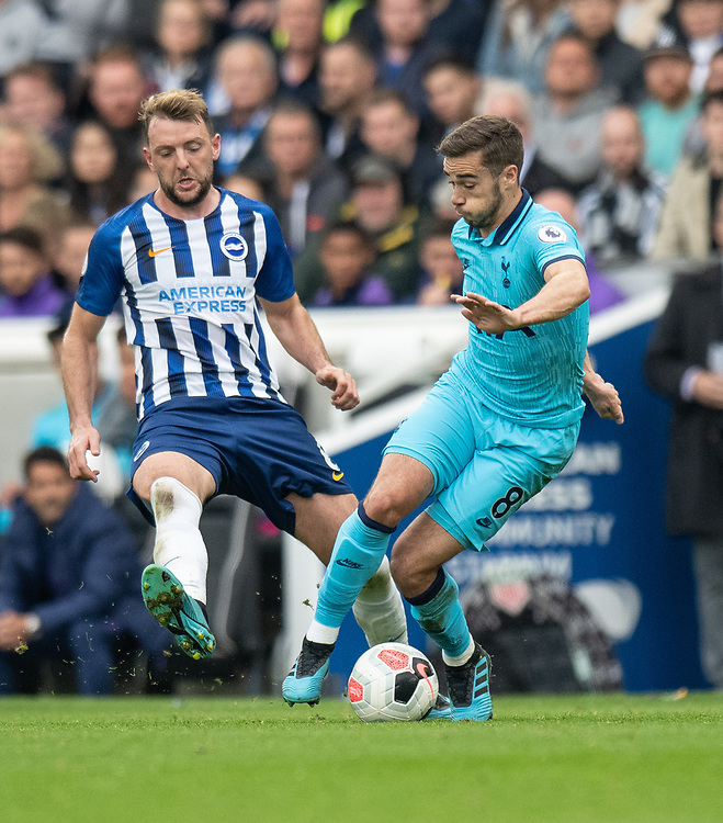 Tottenham Hotspur's Harry Winks (right) under pressure from Brighton & Hove Albion's Dale Stephens (left) <br /> <br /> Photographer David Horton/CameraSport<br /> <br /> The Premier League - Brighton and Hove Albion v Tottenham Hotspur - Saturday 5th October 2019 - The Amex Stadium - Brighton<br /> <br /> World Copyright © 2019 CameraSport. All rights reserved. 43 Linden Ave. Countesthorpe. Leicester. England. LE8 5PG - Tel: +44 (0) 116 277 4147 - admin@camerasport.com - www.camerasport.com