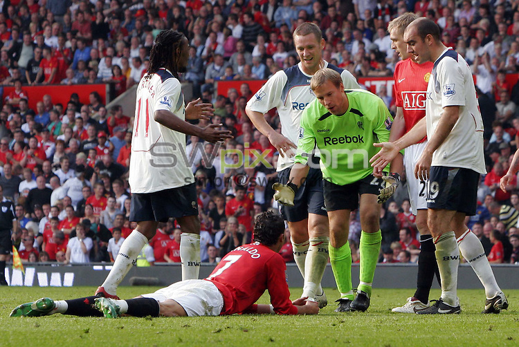 PICTURE by Ben Duffy/SWPIX.COM - Premier League Football, Manchester United v Bolton Wanderers.....27/09/08..Copyright - Simon Wilkinson - 07811267706 ..Man Utd's Cristiano Ronaldo is confronted after going down in the box to win a penalty