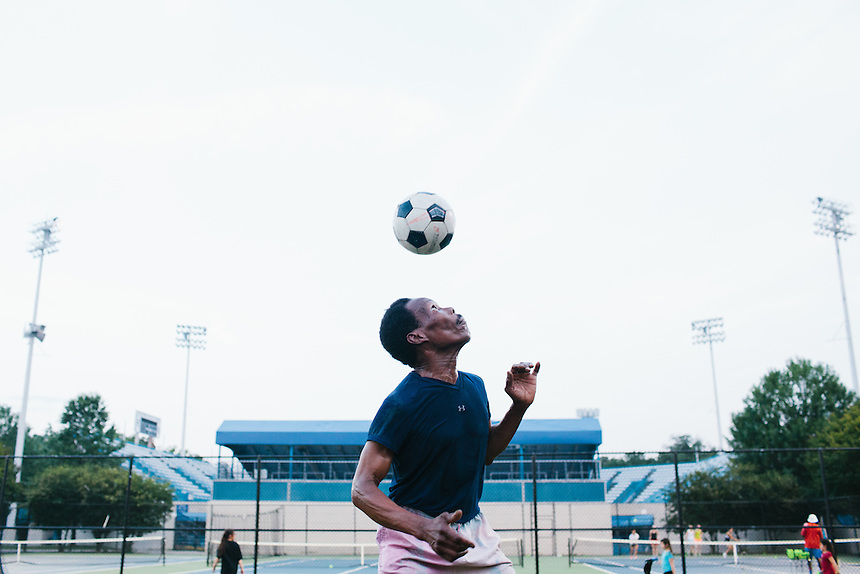 WASHINGTON, DC - JUNE 16, 2014: Codroy Edwards regularly practices soccer in Rock Creek Park. Mr. Edwards likes to practice alone in addition to playing pick up games, because he can spend more time with the ball. (Photo by Lance Rosenfield/Prime for The Washington Post)
