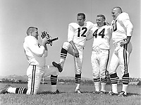 Raiders family day, Wayne Hawkins takes photo of .Tom Flores, (unidentified #44) and Jim Otto..photo/Ron Riesterer