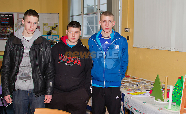 Lee Maguire, Alex Grendon and Cormac Kerrigan alongside some of the crafts that were available at the Youthreach Christmas Party..Picture: Shane Maguire / www.newsfile.ie.