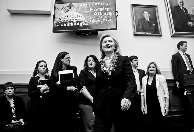 "Secretary of State Hillary Clinton, followed by chairmwoman Ileana Ros-Lehtinen, R-Fla., arrive for the House Foreign Affairs Committee hearing  on ""Assessing U.S. Foreign Policy Priorities and Needs Amidst Economic Challenges"" on Tuesday, March 1, 2011. (Photo By Bill Clark/Roll Call)"