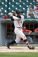 Jacob May (8) of the Charlotte Knights follows through on his swing against the Indianapolis Indians at BB&T BallPark on August 22, 2018 in Charlotte, North Carolina.  The Indians defeated the Knights 6-4 in 11 innings.  (Brian Westerholt/Four Seam Images)