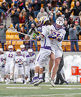 University at Albany Men's Lacrosse defeats Cornell 11-9 on Mar 4 at Casey Stadium.  Sean Eccles (#38)  celebrates Justin Reh's (#11) go-ahead goal.