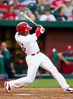 Thomas Pham (22) of the Springfield Cardinals follows through his swing during a game against the St. Louis Cardinals at Hammons Field on April 2, 2012 in Springfield, Missouri. (David Welker/Four Seam Images)