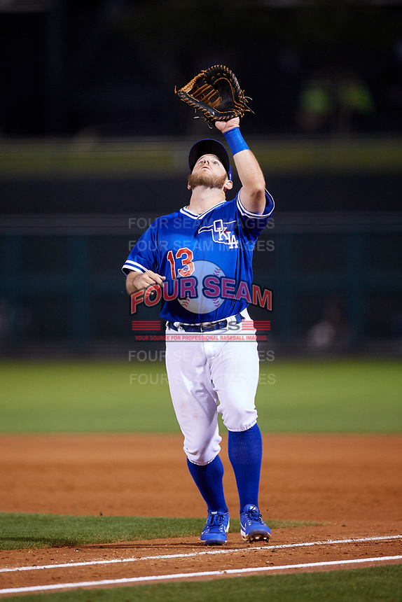 Oklahoma City Dodgers first baseman Max Muncy (13) settles under a pop up during a game against the Colorado Springs Sky Sox on June 2, 2017 at Chickasaw Bricktown Ballpark in Oklahoma City, Oklahoma.  Colorado Springs defeated Oklahoma City 1-0 in ten innings.  (Mike Janes/Four Seam Images)