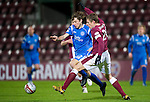 Hearts v St Johnstone....11.01.11  Scottish Cup.Stevie May is tackled by Marius Zaliukas.Picture by Graeme Hart..Copyright Perthshire Picture Agency.Tel: 01738 623350  Mobile: 07990 594431