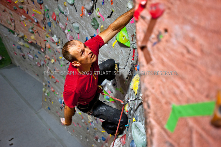 9/20/2011--Seattle, WA, USA..Climber Chad Kellogg training at 6am at Vertical World in Seattle, WASH. Kellogg, 39, is training for the world speed record climb on Mt. Everest that he will attempt in May, 2012. Kellogg climbs solo and without oxygen...A former competitive luger, Kellogg is a Buddhist who wakes everyday at 4 a.m. to meditate before heading out for training and work. A few years ago, Kellogg had part of his colon removed because of cancer and also lost his first wife to a climbing accident...©2011 Stuart Isett. All rights reserved.