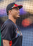20 September 2013: Miami Marlins right fielder Giancarlo Stanton awaits his turn in the batting cage prior to a game against the Washington Nationals at Nationals Park in Washington, DC. The Nationals defeated the Marlins 8-0 to take the second game of their 4-game series. Mandatory Credit: Ed Wolfstein Photo *** RAW (NEF) Image File Available ***