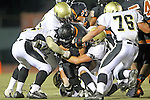 Beverly Hills, CA 09/23/11 - Okuoma Idah (Peninsula #24), Alan Castro (Beverly Hills #34) and unidentified Peninsula player(s) in action during the Peninsula-Beverly Hills Varsity football game.