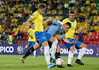 BUCARAMANGA - COLOMBIA, 06-02-2020: Bruno Fuchs y Marcilio Florencio Mota Nino de Brasil disputan el balón con Federico Viñas de Uruguay durante partido entre Brasil U-23 Y Uruguay U-23 por el cuadrangular final como parte del torneo CONMEBOL Preolímpico Colombia 2020 jugado en el estadio Alfonso Lopez en Bucaramanga, Colombia. / Bruno Fuchs and Marcilio Florencio Mota Nino of Brazil fight the ball with Federico Viñas of Uruguay during the match between Brazil U-23 and Uruguay U-23 for the final quadrangular as part of CONMEBOL Pre-Olympic Tournament Colombia 2020 played at Alfonso Lopez stadium in Bucaramanga, Colombia. Photo: VizzorImage / Jaime Moreno / Cont