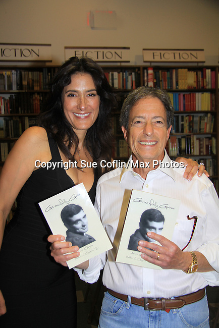 """Neurologist Howard Reiser poses with Another World's Alicia Coppola who speaks and signs her book """"Gracefully Gone"""" - a fusion of two journals: her father Matthew L. Coppola Sr. and hers - on August 23, 2013 at Book Revue, Huntington, New York. (Photo by Sue Coflin/Max Photos)"""