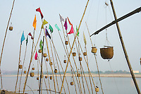 lights for the gods -around Diwali time,  October Hindus offer candle lights in baskets on bamboo poles to the gods at river Ganga, Varanasi