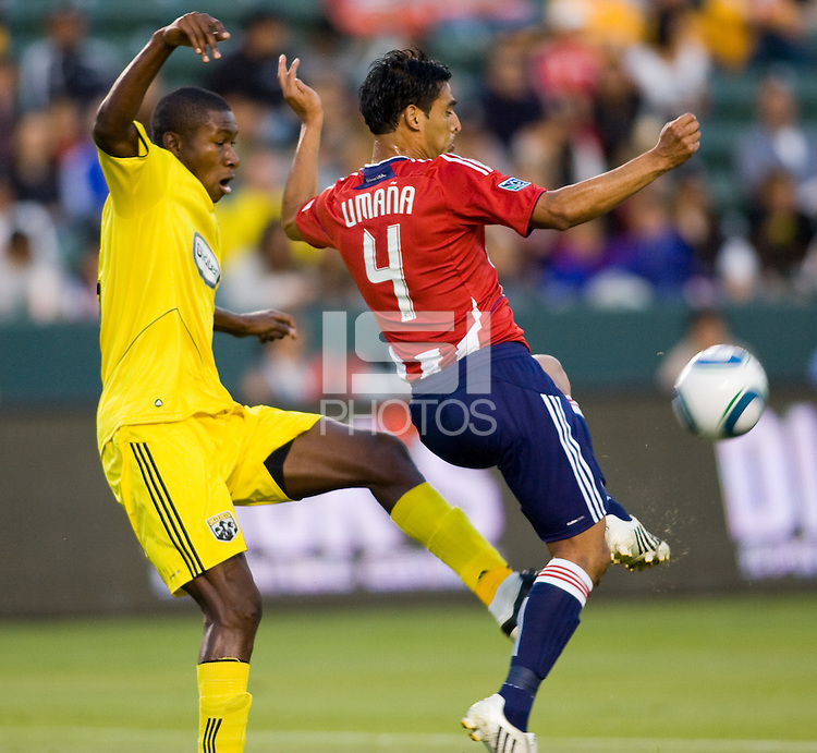 Chivas USA defender Michael Umana (4) beats Columbus Crew defender Andy Iro (6) to the ball. CD Chivas USA defeated the Columbus Crew 3-1 at Home Depot Center stadium in Carson, California on Saturday July 31, 2010.