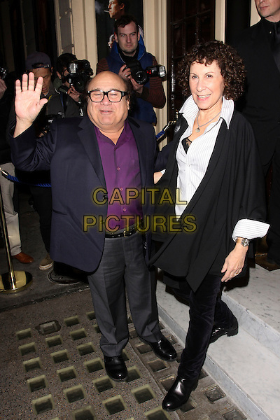 "DANNY DEVITO & RHEA PERLMAN  .Press night for ""The Children's Hour"" at the Comedy Theatre, London, England, UK,.February 9th 2011..full length married husband wife purple shirt suit black white glasses jacket hand palm waving .CAP/AH.©Adam Houghton/Capital Pictures."