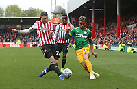 Preston North End's Josh Ginnelly and Brentford's Henrik Dalsgaard<br /> <br /> Photographer Rob Newell/CameraSport<br /> <br /> The EFL Sky Bet Championship - Brentford v Preston North End - Sunday 5th May 2019 - Griffin Park - Brentford<br /> <br /> World Copyright © 2019 CameraSport. All rights reserved. 43 Linden Ave. Countesthorpe. Leicester. England. LE8 5PG - Tel: +44 (0) 116 277 4147 - admin@camerasport.com - www.camerasport.com