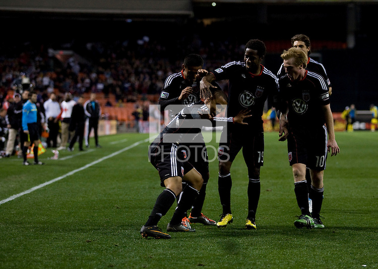 Charlie Davies (9) of D.C. United celebrates his goal with teammates during the home opener at RFK Stadium in Washington D.C.  D.C. United defeated the Columbus Crew, 3-1.