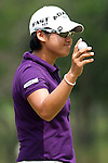 CHON BURI, THAILAND - FEBRUARY 17:  Yani Tseng of Taiwan acknowledges to the crowd on the 4th green during day one of the LPGA Thailand at Siam Country Club on February 17, 2011 in Chon Buri, Thailand.  Photo by Victor Fraile / The Power of Sport Images