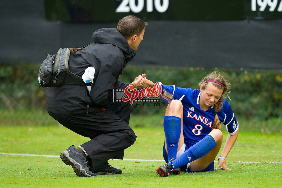 Haley Yearout (8) of the Kansas Jayhawks is helped up by trainer John Zirkelbach during a stoppage in the match against the Wake Forest Demon Deacons at Spry Soccer Stadium on October 7, 2012 in Winston-Salem, North Carolina.  The Demon Deacons and the Jayhawks battled to a 1-1 tie in double overtime.  (Brian Westerholt/Sports On Film)