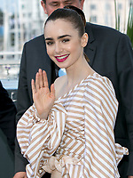 Lily Collins poses at the photocall of the movie 'Okja' during the 70th Annual Cannes Film Festival at Palais des Festivals in Cannes, France, on 19 May 2017. - NO WIRE SERVICE · Photo: Hubert Boesl/dpa /MediaPunch ***FOR USA ONLY***