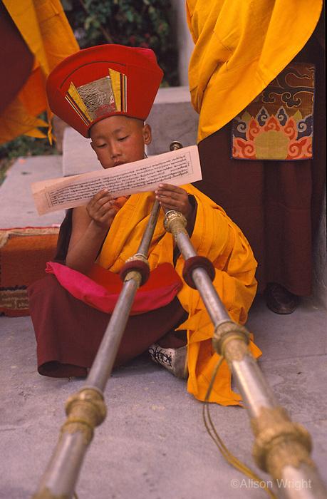 Tibean lama in puja in Nepal.