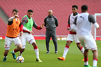 Arsenal Under 18 Coach, Kwame Ampadu, keeps a close eye on his team in the pre-match warm up ahead of kick-off during Arsenal Youth vs Blackpool Youth, FA Youth Cup Football at the Emirates Stadium on 16th April 2018
