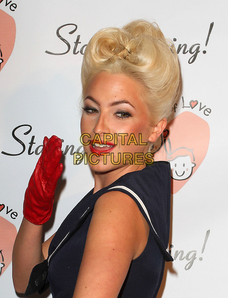JULIETTE BEAVAN.Charitable event to benefit ìLocks of Loveî held at Sky Bar at The Mondrian, West Hollywood, CA, USA.  .October 6th, 2010.half length red leather gloves lipstick hair up blue sleeveless headshot portrait .CAP/ADM/KB.©Kevan Brooks/AdMedia/Capital Pictures.