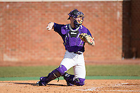 Spencer Brown (26) of the High Point Panthers warms up the pitcher between innings of the game against the UNCG Spartans at Willard Stadium on February 14, 2015 in High Point, North Carolina.  The Panthers defeated the Spartans 12-2.  (Brian Westerholt/Four Seam Images)