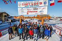 Some of the official finishers of the 2017 race pose for a group photo in the finish chute in Nome during the 2017 Iditarod on Saturday March 18, 2017.<br /> <br /> Photo by Jeff Schultz/SchultzPhoto.com  (C) 2017  ALL RIGHTS RESERVED