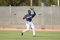 Milwaukee Brewers right fielder Larry Ernesto (24) catches a fly ball during an Instructional League game against the Los Angeles Dodgers at Maryvale Baseball Park on September 24, 2018 in Phoenix, Arizona. (Zachary Lucy/Four Seam Images)
