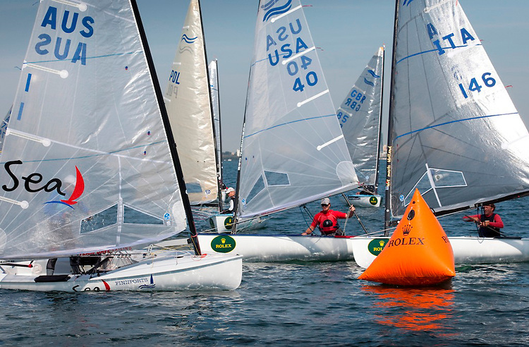 Slow action in the Finn class at the leeward mark...from left: AUS 1, Brendan Casey, Finn..USA 40, Luke Lawrence, Finn, ..ITA 146, Michele Paoletti, Finn..