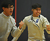 Jonathan Sheng of Jericho, left, and teammate Matthew Gavieta react as the Jayhawks close in on victory over Ward Melville in the boys fencing Long Island Championship at Jericho High School on Tuesday, Feb. 6, 2017.