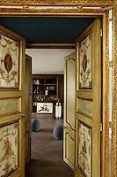 The original hand-painted and gilded 17th century doors open into the library