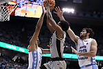 CHAPEL HILL, NC - DECEMBER 30: Wake Forest's Bryant Crawford (13) is defended by North Carolina's Garrison Brooks (15) and Luke Maye (32). The University of North Carolina Tar Heels hosted the Wake Forest University Demon Deacons on December 30, 2017 at Dean E. Smith Center in Chapel Hill, NC in a Division I men's college basketball game. UNC won the game 73-69.