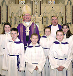 Most Rev. Dr. Sean Brady, Archbishop of Armagh and Very Rev. James Shevlin, P.P., Dunleer with servers front l/r : Ciaran Kearney, Ian Mulroy and James Mc keown. Back l/r: Julie-Anne Mc keown, Emily Callan and Leah Carrie at the Re-Dedication of St. Brigid's Church, Dunleer...Picture Fran Caffrey Newsfile.
