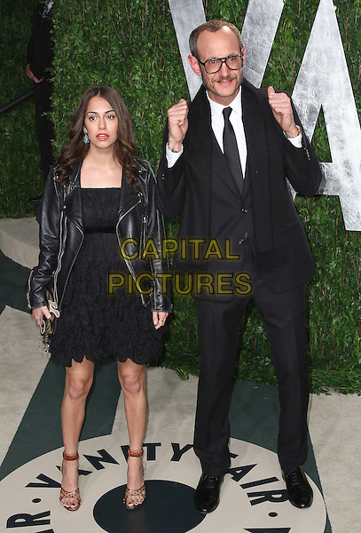 guest & Terry Richardson.2012 Vanity Fair Oscar Party held at the Sunset Tower West Hollywood, California, USA..26 February 2012.oscars full length black suit leather jacket dress hands thumbs up.CAP/ADM/FS.©Faye Sadou/AdMedia/Capital Pictures.
