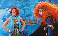 "La cantante Noemi, interprete della colonna sonora, posano durante il photocall per la presentazione del nuovo film di animazione della Disney-Pixar ""Ribelle - The Brave"" a Roma, 27 giugno 2012..U.S. director Mark Andrews and italian singer Noemi, who played the italian version sound track, poses during the photocall for the presentation of the new Disney-Pixar animation movie ""The Brave"" in Rome, 27 june 2012..UPDATE IMAGES PRESS/Isabella Bonotto"