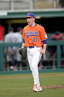 Relief pitcher Geoffrey Gilbert (31) of the Clemson Tigers shouts after ending a bases-loaded threat with a strikeout in a game against the Stony Brook Seawolves on Friday, February 21, 2020, at Doug Kingsmore Stadium in Clemson, South Carolina. Clemson won, 2-0. (Tom Priddy/Four Seam Images)